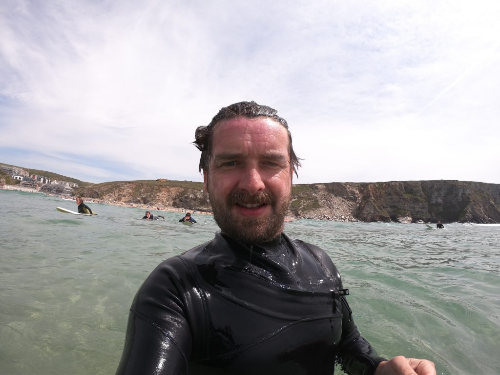 To illustrate the fact Alex is a surf instructor in Cornwall teaching EFL students how to surf